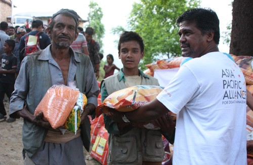 A-PAD Sri Lanka's Firzan Hashim distributing food items in Kubhinde village